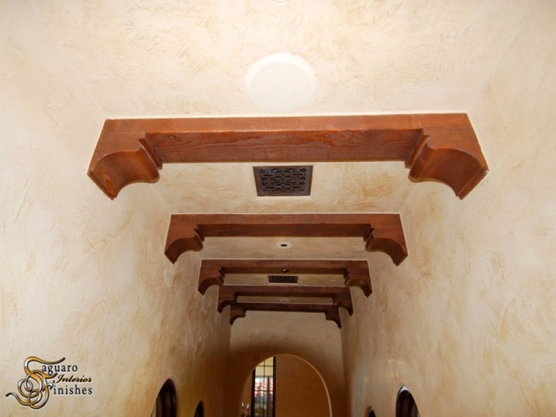 Hallway ceiling detail with wood beams and Venetian plaster