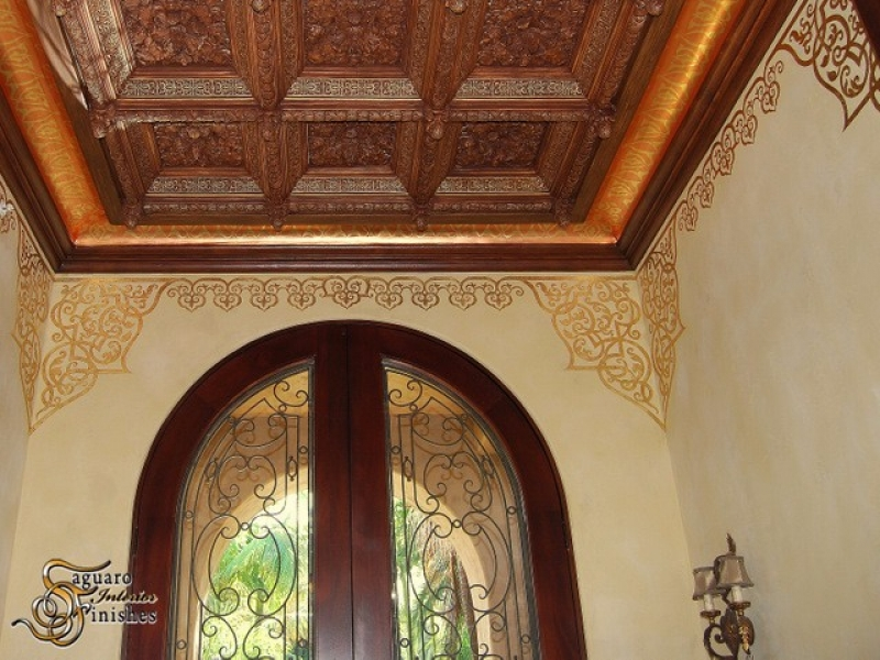 Venetian plaster and custom coffered ceiling with artwork detailing