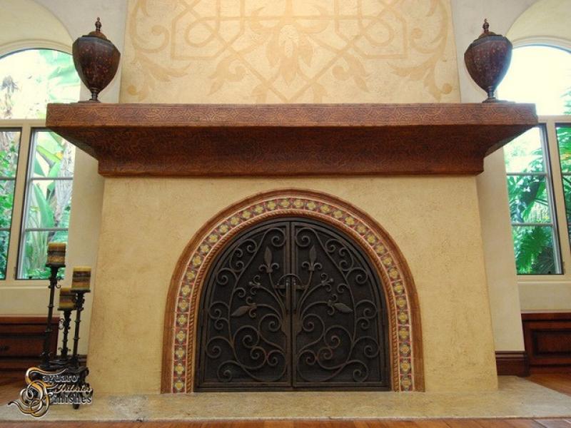 Fireplace detailing custom artwork on Venetian plaster finish