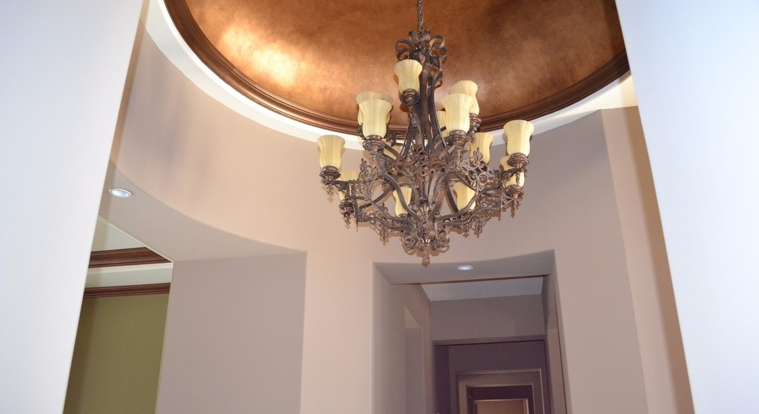 domed ceiling detail with metallic finish